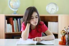 Kid doing homework Royalty Free Stock Image