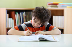 Kid doing homework Royalty Free Stock Photos