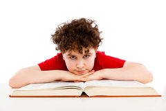 Kid doing homework Stock Photos