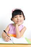 Kid is doing homework Stock Image