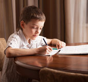 Kid doing homework Royalty Free Stock Images