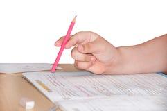 Kid doing homework mathematics on the table Royalty Free Stock Photo