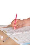 Kid doing homework mathematics on the table Royalty Free Stock Photography