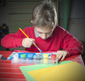 Kid doing homework painting, early education Stock Photography