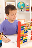 Kid doing math exercise Stock Photos