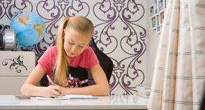 Kid doing math homework Stock Photos