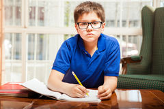 Kid doing some homework Stock Photos