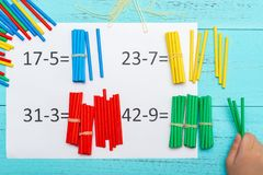 Kid doing subtraction equation using counting rods. Kid doing subtraction equations using counting rods stock photo