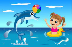 Kid and Dolphin Playing with Ball Royalty Free Stock Image