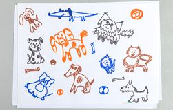 Kid doodle set of cute outline dogs with bones and balls royalty free stock photos