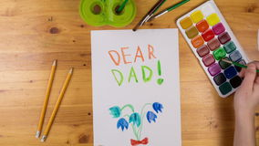 Kid draw greeting card for fathers day, stop motion animation stock video footage