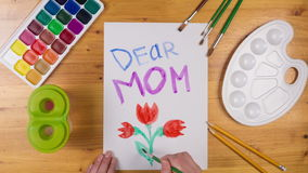Kid draw greeting card for mothers day, stop motion animation stock footage