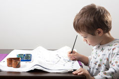 Kid drawing Stock Photo