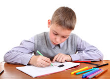 Kid is Drawing Royalty Free Stock Images
