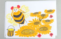 Kid drawing of bee flying over flowers collecting nectar and making honey. Kid drawing of bee flying over flowers collecting pollen and making honey isolated on stock photography