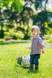 Kid drawing a cart with flowers Stock Photo