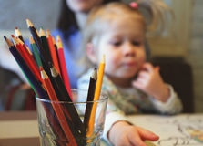 Kid drawing, color pencil in the glass Stock Image