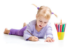 Kid drawing with color pencils Stock Photos