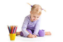 Kid drawing with color pencils Royalty Free Stock Photos