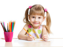 Kid drawing with colourful pencils Stock Photography