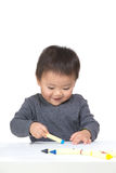 Kid drawing with crayon Royalty Free Stock Image