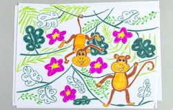 Kid drawing of cute monkeys on plants isolated on white background royalty free stock photography