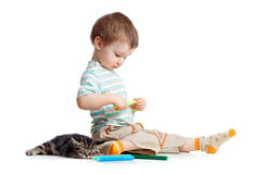 Kid drawing felt pens with cat. On white stock images
