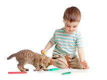 Kid drawing felt pens with cat. On white stock image