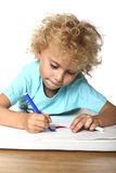 Kid drawing on floor Royalty Free Stock Photography