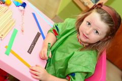 Kid drawing at home or school. Happy smiling kid drawing at home or school kindergarden Stock Photos