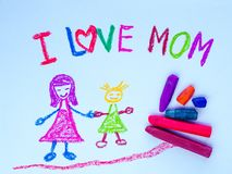 Kid drawing of mother holding her daughter. For happy mother`s day theme Royalty Free Stock Photography