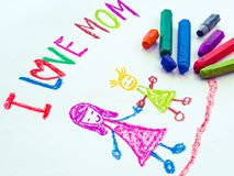Kid drawing of mother holding her daughter. For happy mother`s day theme Stock Photo