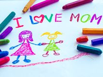 Kid drawing of mother holding her daughter. For happy mother`s day theme Stock Photos