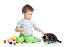 Kid drawing paints with cat. On white stock image