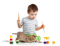 Kid drawing paints with cat. Kitten stock photography
