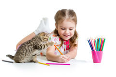 Kid drawing with pencils and playing with kitten Royalty Free Stock Photography