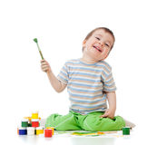 Kid drawing with watercolor paints Stock Image