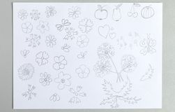 Kid drawings set of different flower heads fruits and butterfly. Isolated on white background - gray pencil outline child scribble of cute blooms and leaves royalty free stock photo