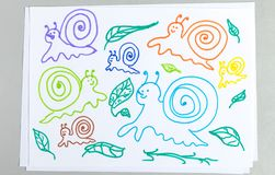 Kid drawings set of different snails and plant leaves stock image