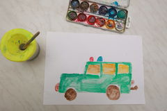 Kid draws car a watercolor brush Royalty Free Stock Image