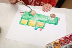 Kid draws car a watercolor brush Stock Photography