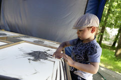Kid draws with sand Royalty Free Stock Photo