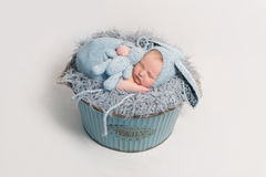 Kid dressed as rabbit sleeping with blue toy Stock Photography