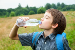Kid drink water oudoors Royalty Free Stock Images