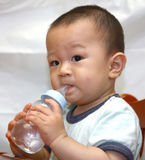 Kid drinking Stock Image