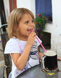 Kid drinking a drink Royalty Free Stock Image