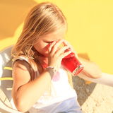 Kid drinking a drink Stock Images