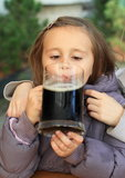 Kid drinking a drink Royalty Free Stock Photo