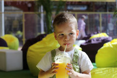 Kid drinking fresh juice Stock Photo