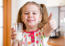 Kid drinking milk from glass Royalty Free Stock Images